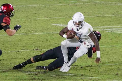 UNLV's Justin Rogers is sacked by San Diego State's Connor Mitchell during Saturday's Mount ...