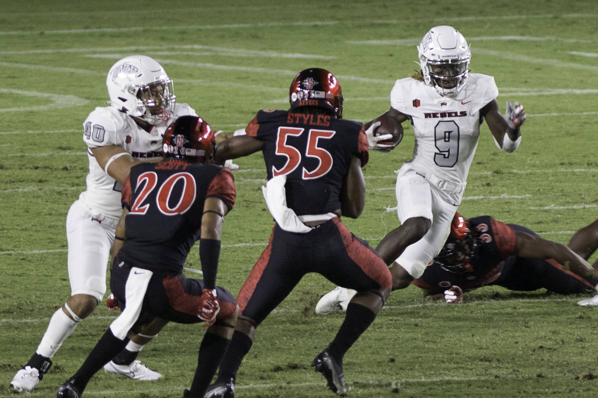 UNLV's Tyleek Collins runs the ball back on a kickoff return during Saturday's Mountain West ...