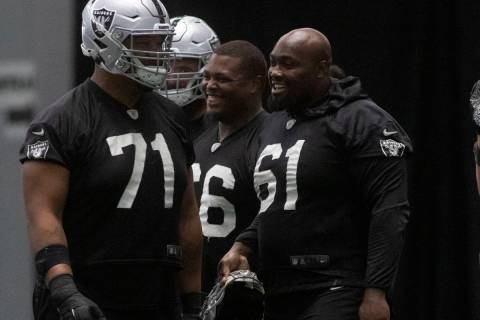 Raideres offensive linemen Denzelle Good (71), Gabe Jackson (66), Rodney Hudson (61) and tight ...