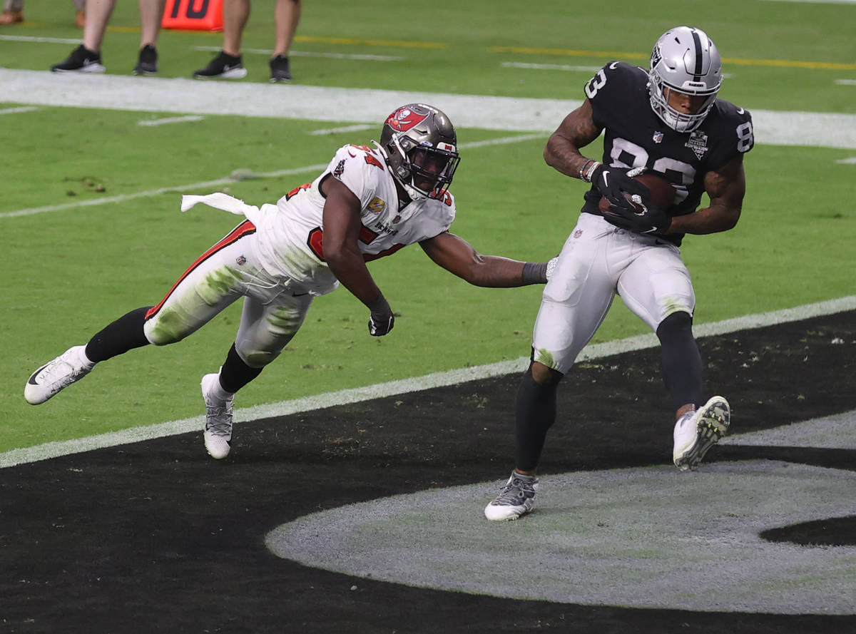 Las Vegas Raiders tight end Darren Waller (83) pulls in a touchdown pass in front of Tampa Bay ...