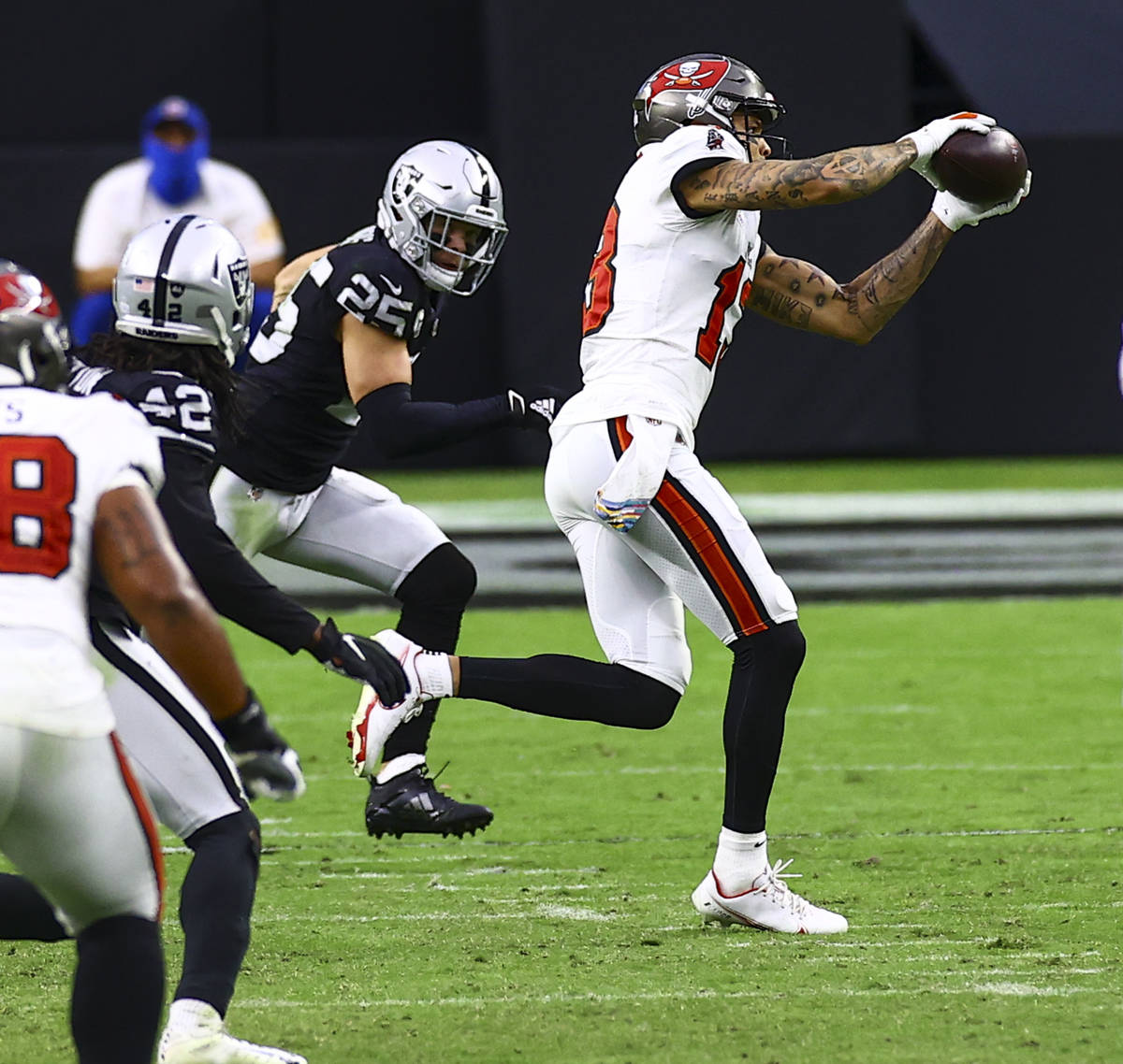 Tampa Bay Buccaneers wide receiver Mike Evans (13) catches a pass in front of Las Vegas Raiders ...