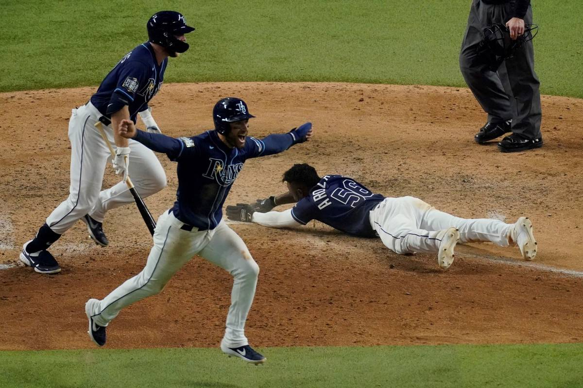 Tampa Bay Rays' Randy Arozarena celebrates after scoring the winning run in Game 4 of the World ...