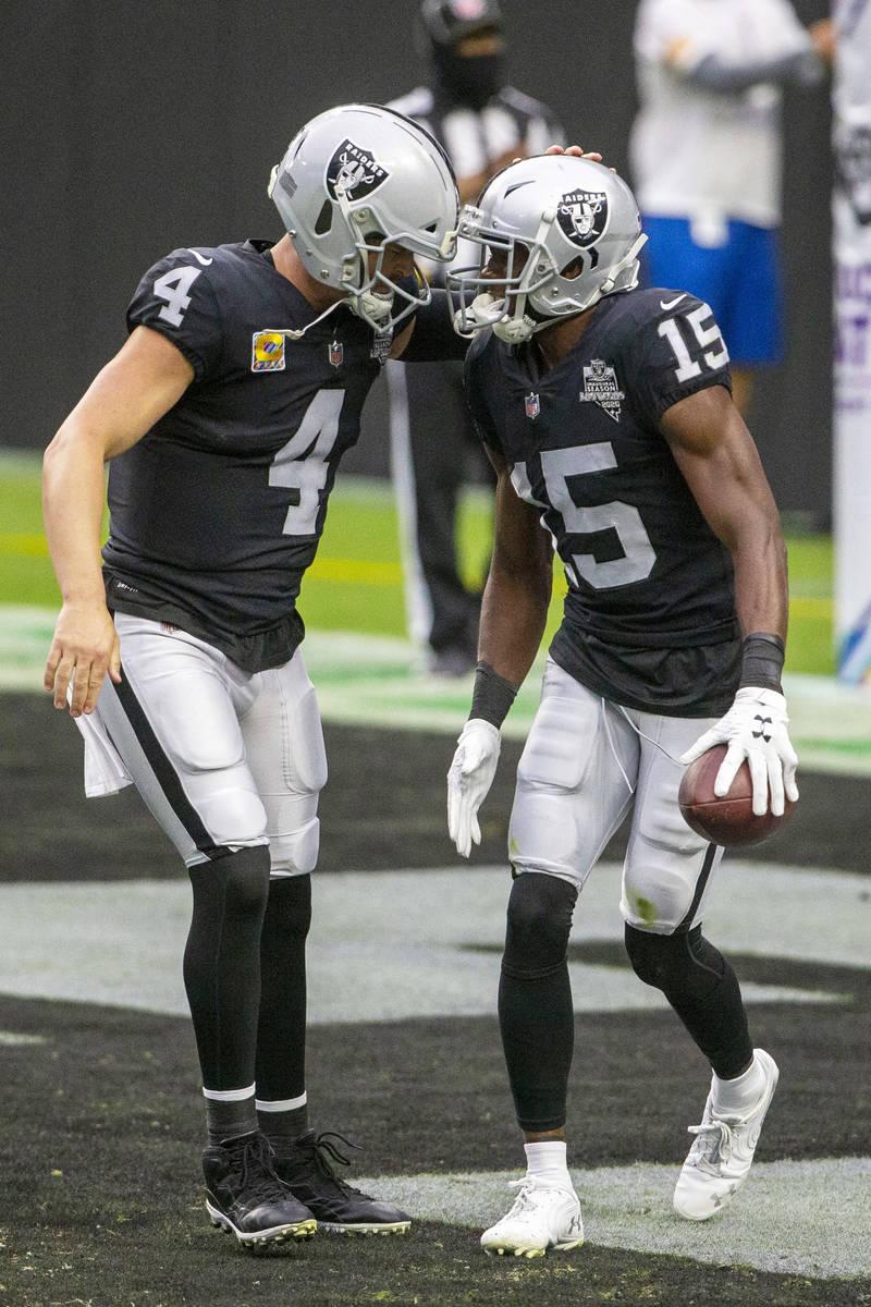 Las Vegas Raiders wide receiver Nelson Agholor (15) celebrates his touchdown with quarterback D ...