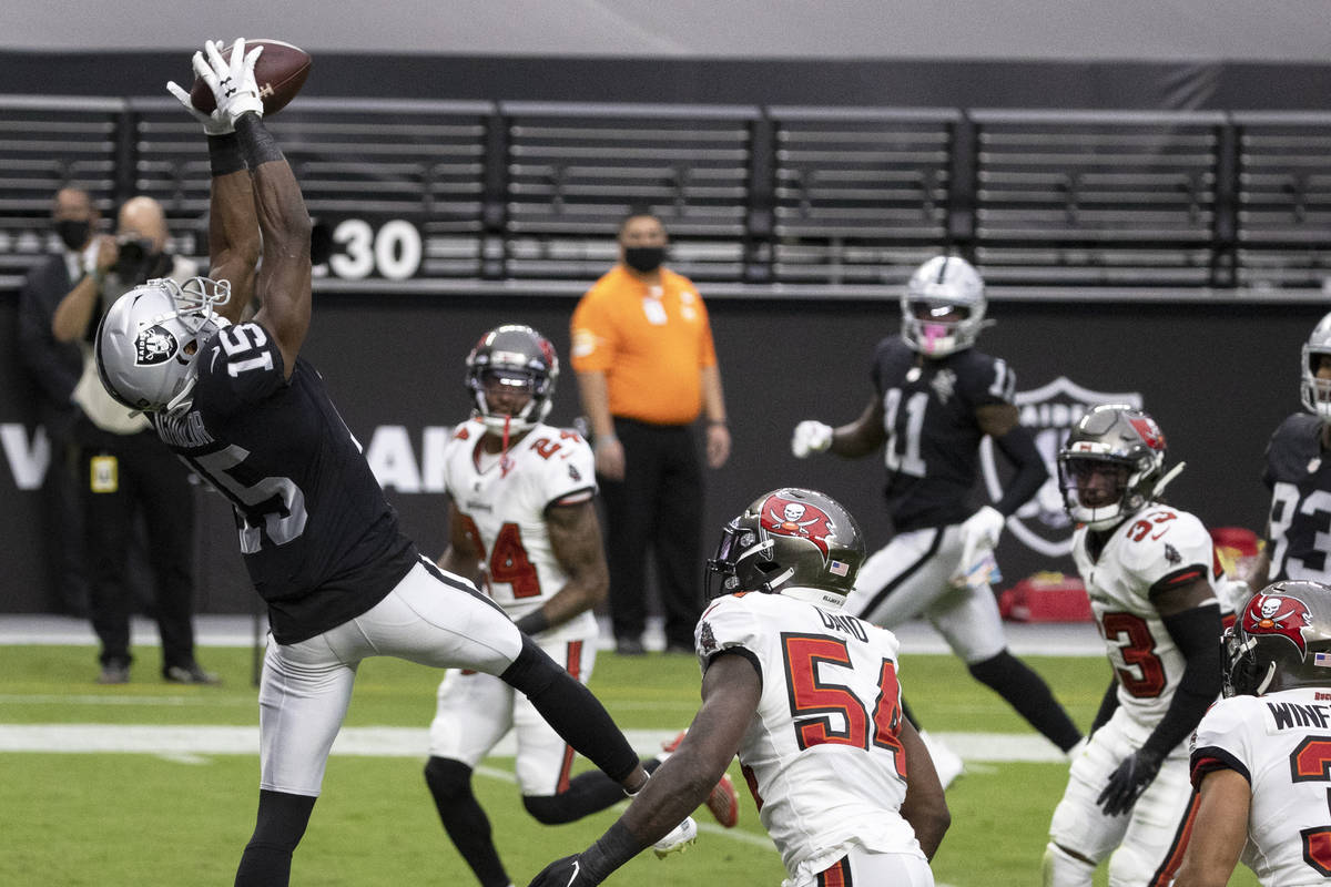 Las Vegas Raiders wide receiver Nelson Agholor (15) makes a touchdown catch over Tampa Bay Bucc ...