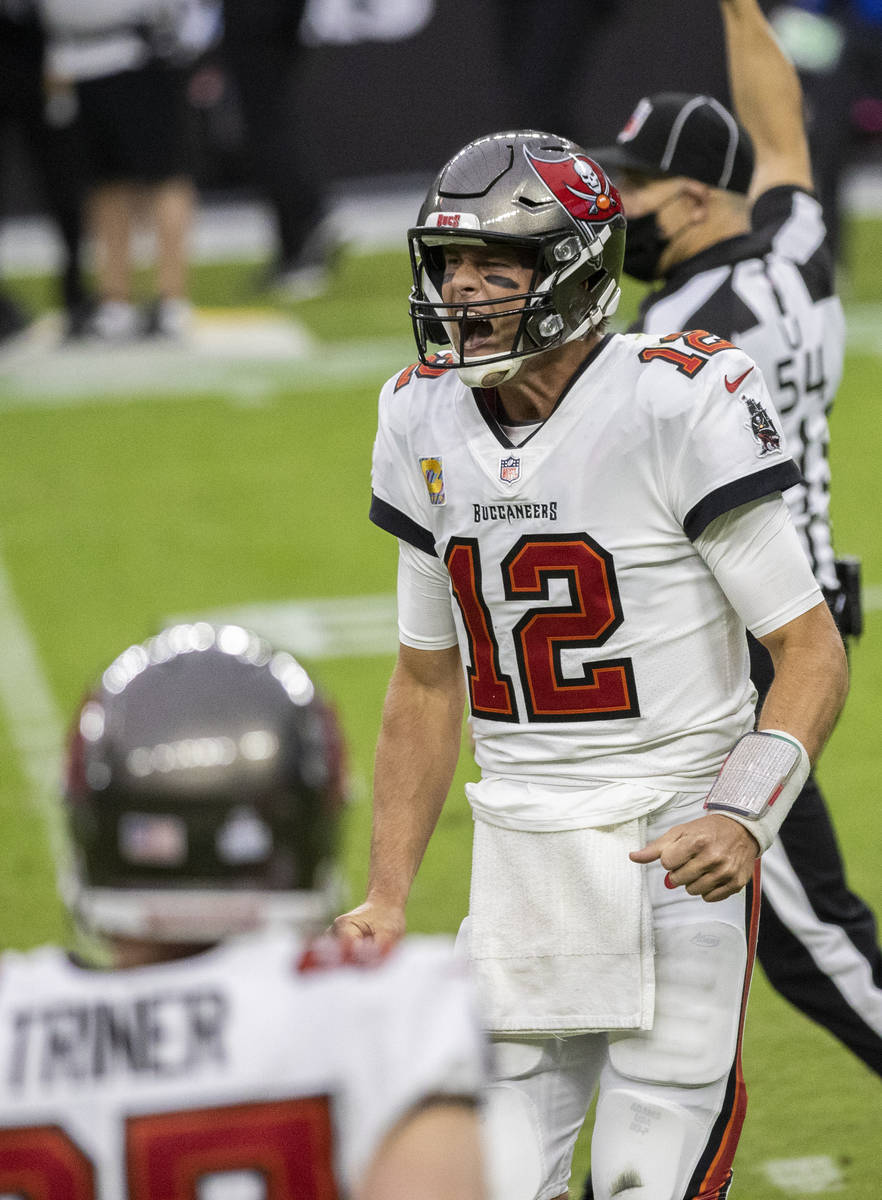 Tampa Bay Buccaneers quarterback Tom Brady (12) fires up his team in the third quarter during a ...