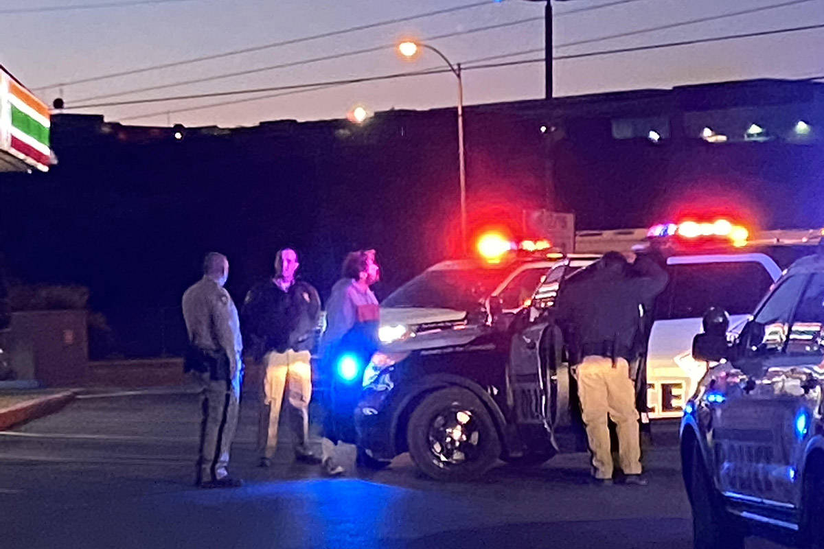 Las Vegas police detain a man near Mountain Vista Street and East Tropicana Avenue about 5:20 a ...