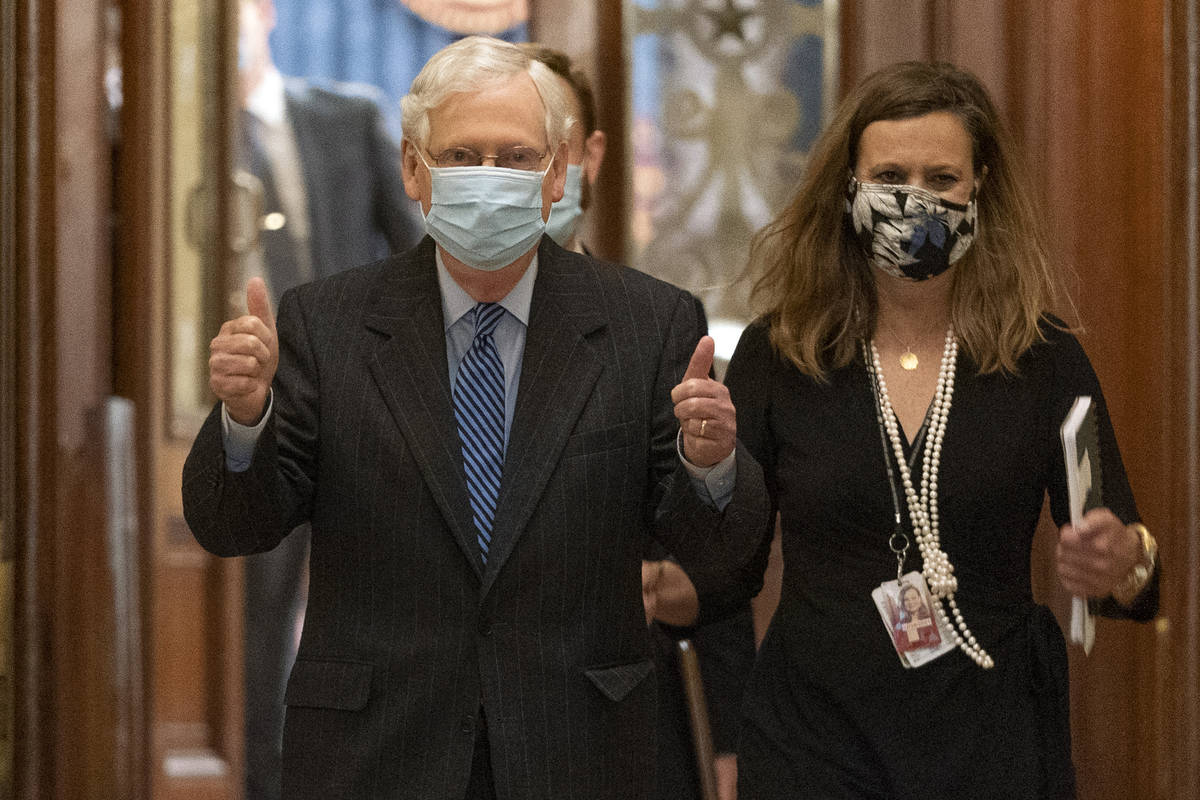 Senate Majority Leader Mitch McConnell of Ky., reacts with two thumbs up as he leaves the chamb ...