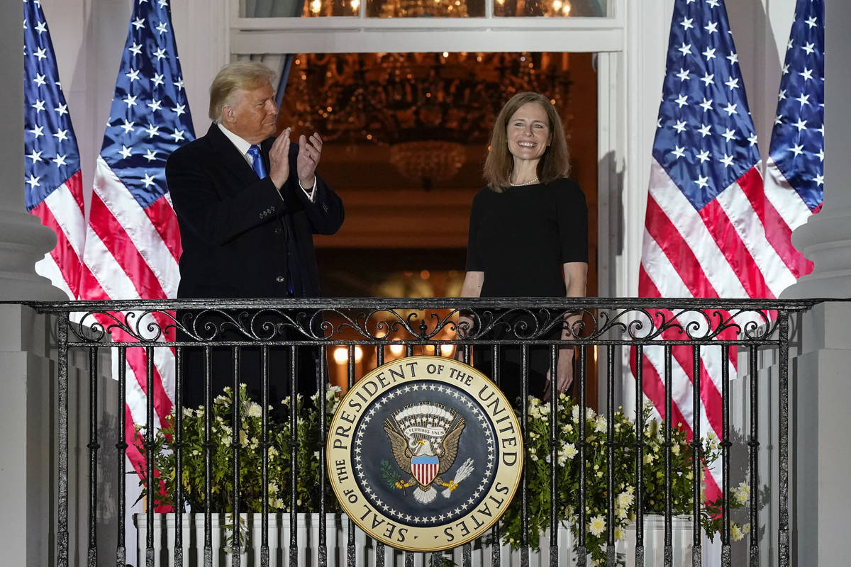 President Donald Trump and Amy Coney Barrett stand on the Blue Room Balcony after Supreme Court ...