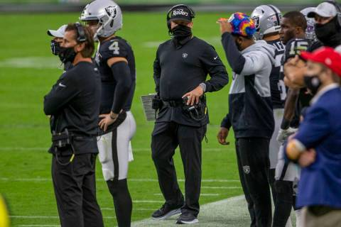 Las Vegas Raiders head coach Jon Gruden, center, walks the sideline during the 4th quarter of a ...