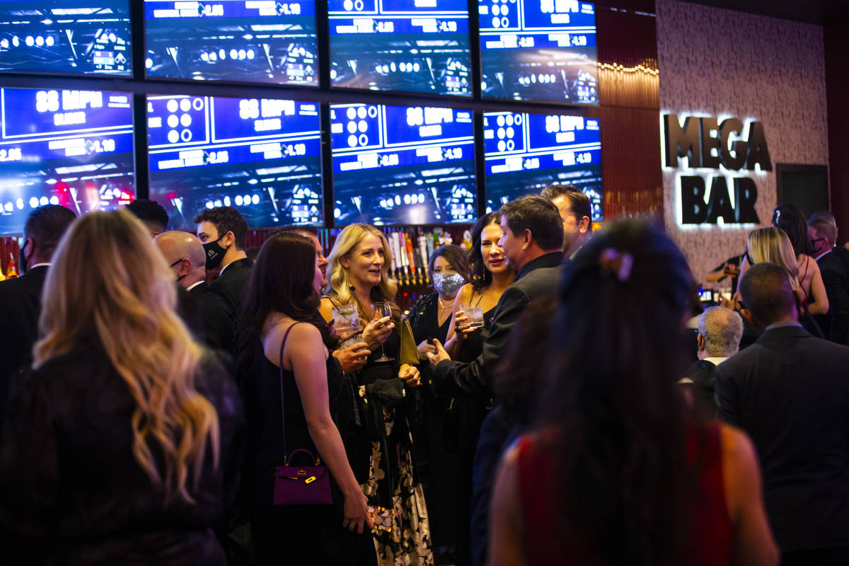 Invited guests enjoy drinks by the Mega Bar at Circa during the VIP black-tie grand opening eve ...