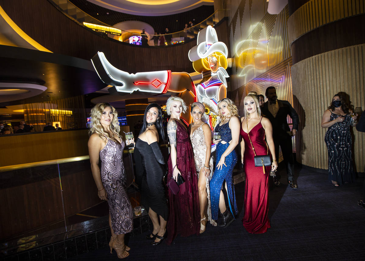 Invited guests pose for photos with Vegas Vickie at Circa during the VIP black-tie grand openin ...