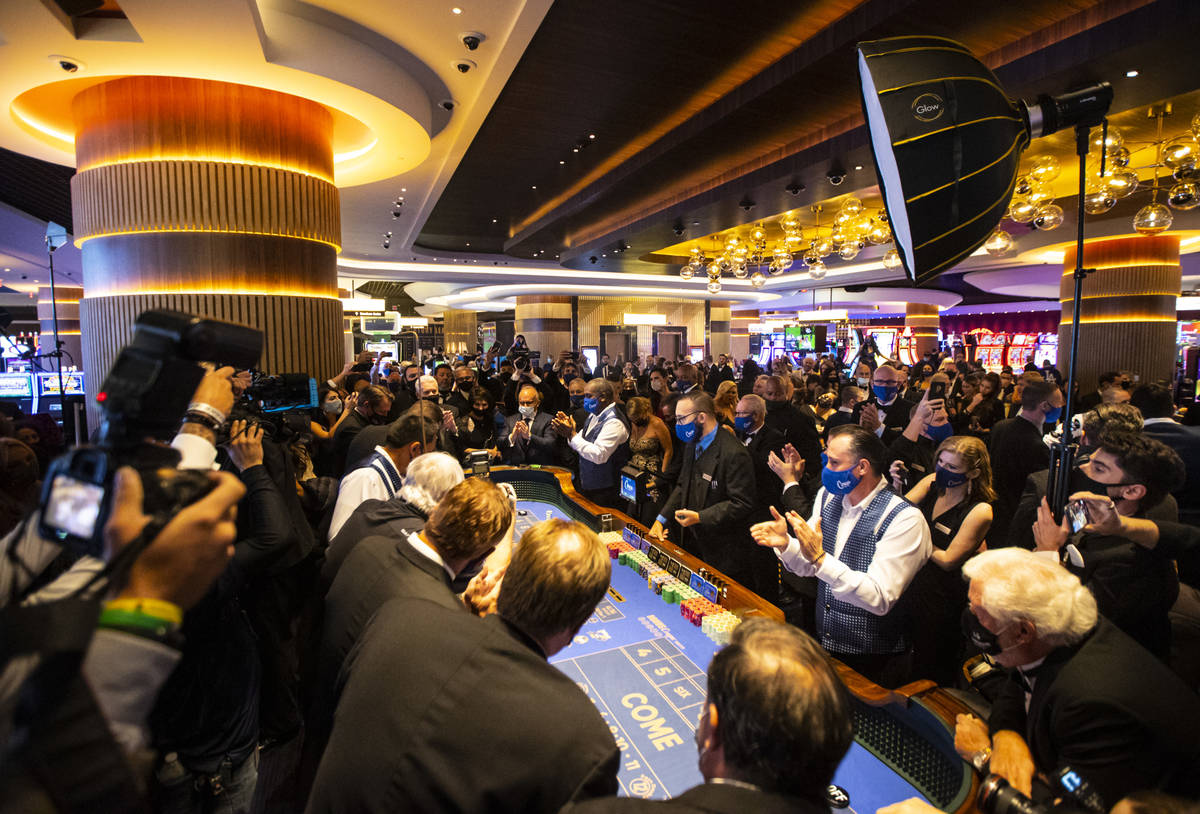 Dealers clap right before the first roll of the dice is thrown at a craps table at Circa during ...