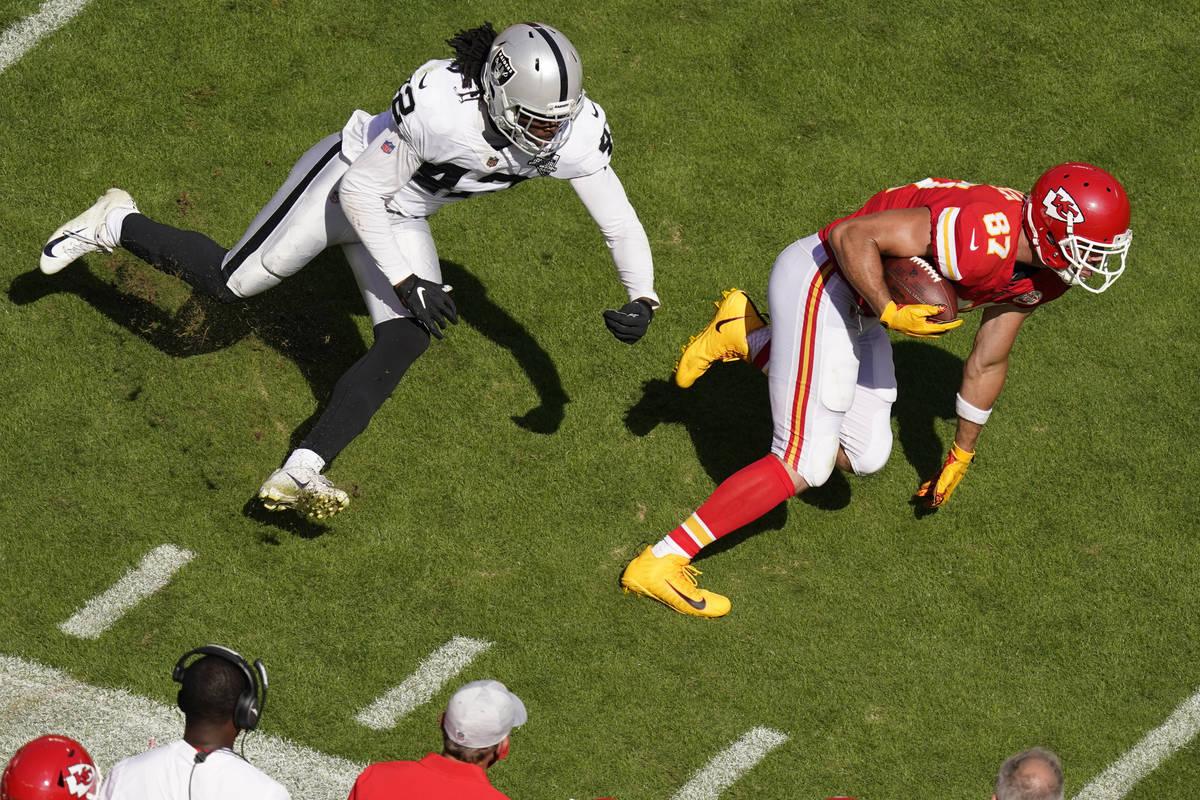 Kansas City Chiefs tight end Travis Kelce (87) runs from Las Vegas Raiders inside linebacker Co ...
