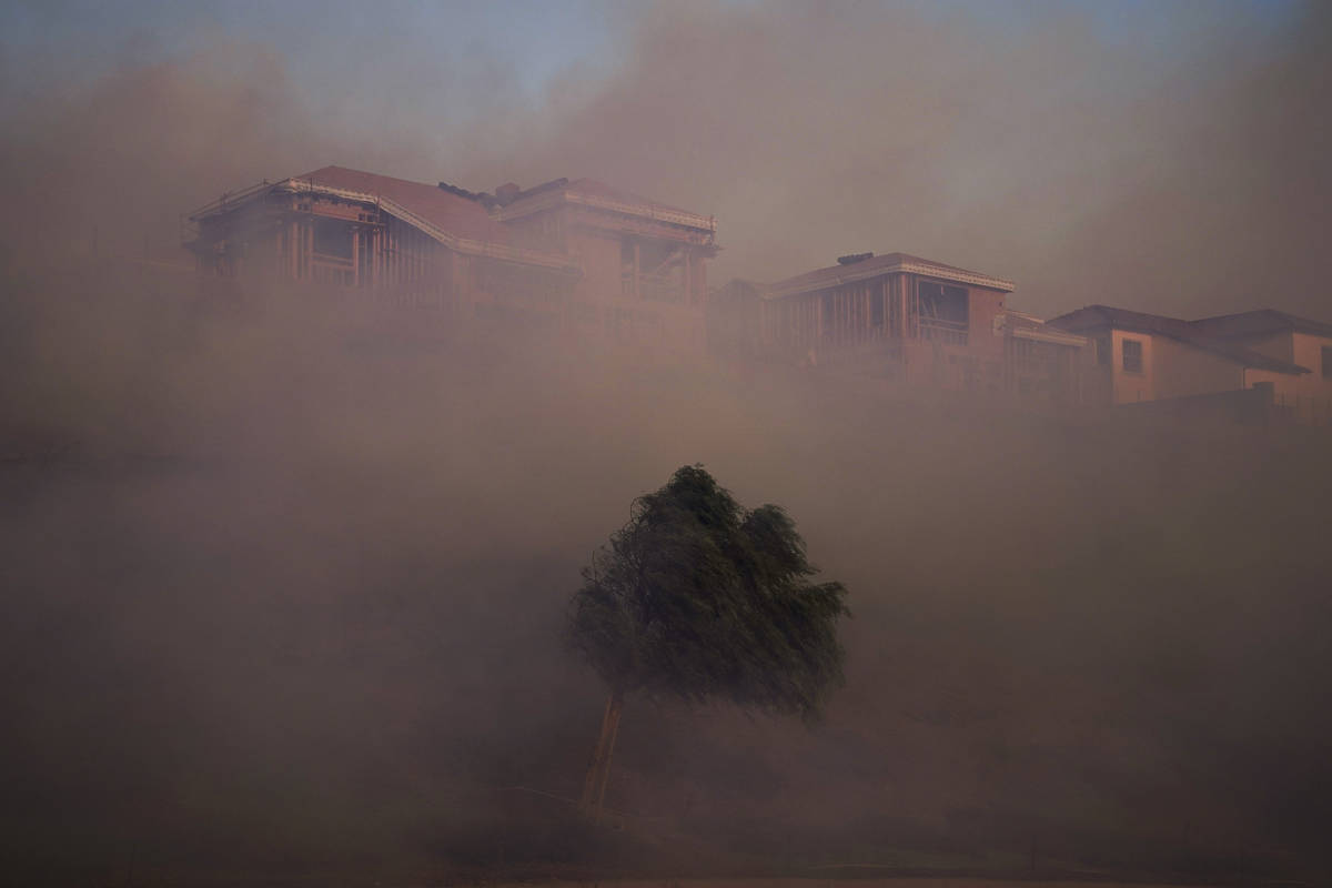 Gusting winds carry smoke from the Silverado Fire into residential areas Monday, Oct. 26, 2020, ...