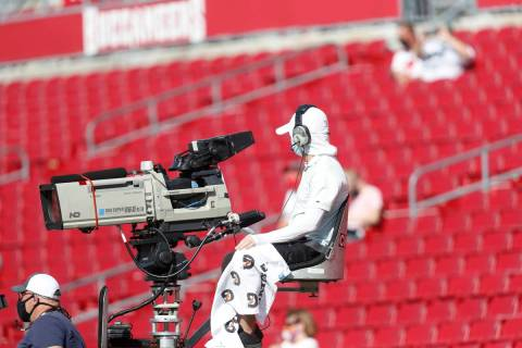 A NFL camera man works before an NFL football game, Sunday, Oct. 18, 2020, in Tampa, Fla. (AP P ...