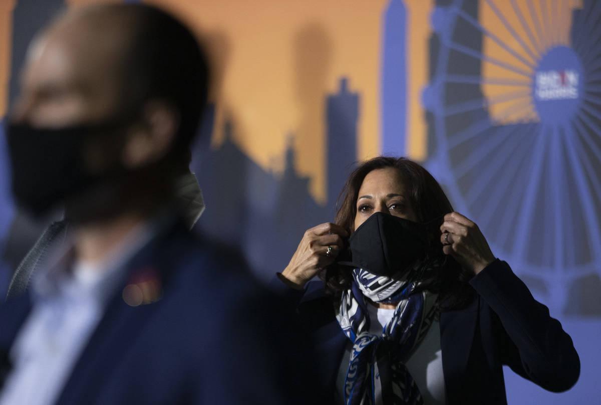 Sen. Kamala Harris puts her mask back on after speaking at Kianga Isoke Palacio Park on Tuesday ...