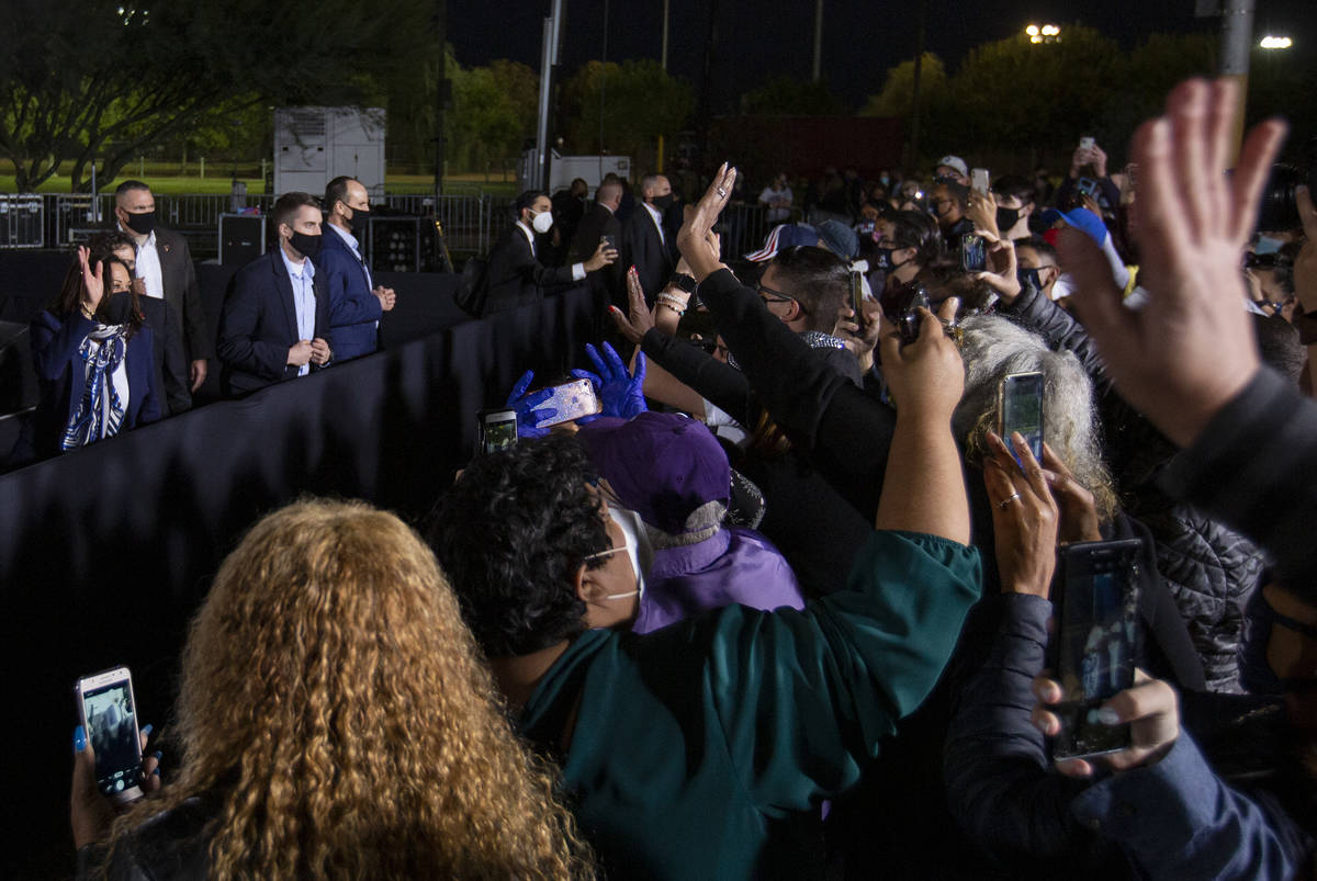 A crowd of audience members gathers to wave to vice presidential candidate Sen. Kamala Harris f ...