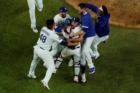Los Angeles Dodgers celebrate after defeating the Tampa Bay Rays 3-1 to win the baseball World ...