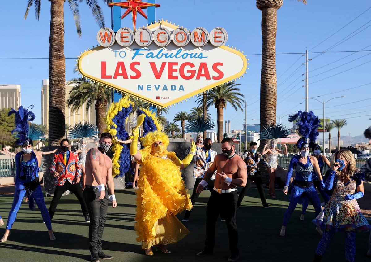 "Las Vegas performers, including Jim ""Auntie Norma Llyaman"" McCoy, front, people kick off a mult ..."