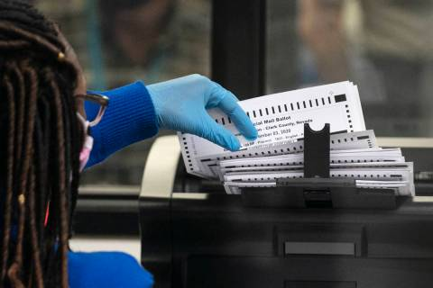 A Clark County election worker scans ballots at the Election Department warehouse, on Tuesday, ...