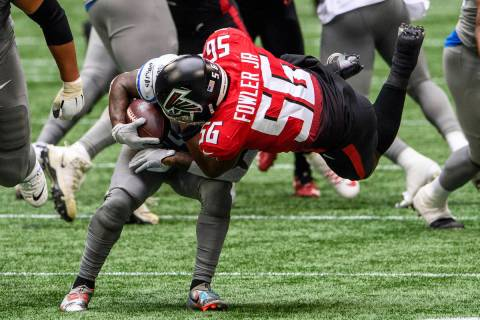 Atlanta Falcons defensive end Dante Fowler Jr. (56) tackles Detroit Lions running back D'Andre ...