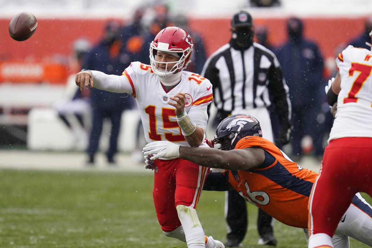 Kansas City Chiefs quarterback Patrick Mahomes throws a pass under pressure from Denver Broncos ...