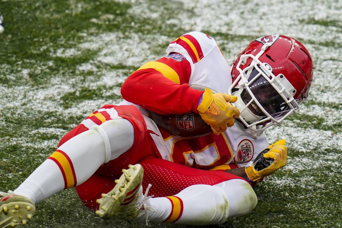 Kansas City Chiefs wide receiver Tyreek Hill (10) scores a touchdown against the Denver Broncos ...