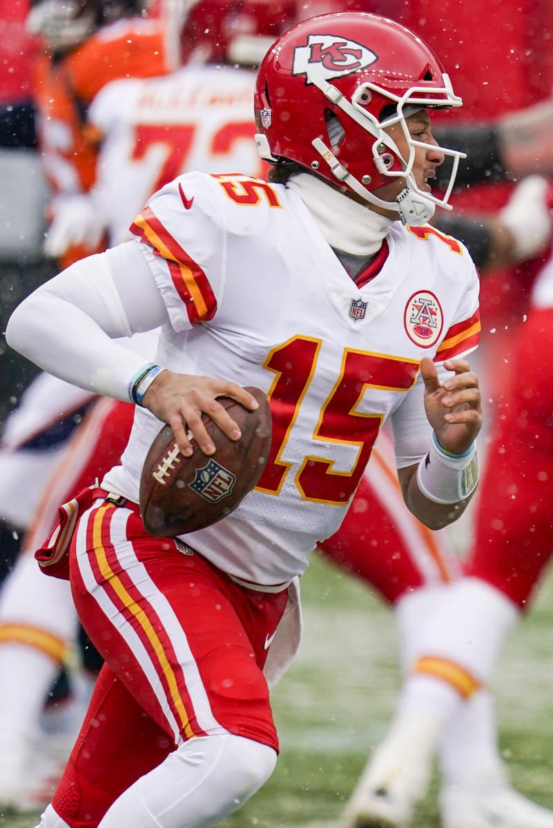 Kansas City Chiefs quarterback Patrick Mahomes (15) scrambles against the Denver Broncos during ...