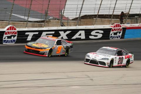 Noah Gragson (9) and Harrison Burton (20) come out of turn four onto the front stretch during a ...