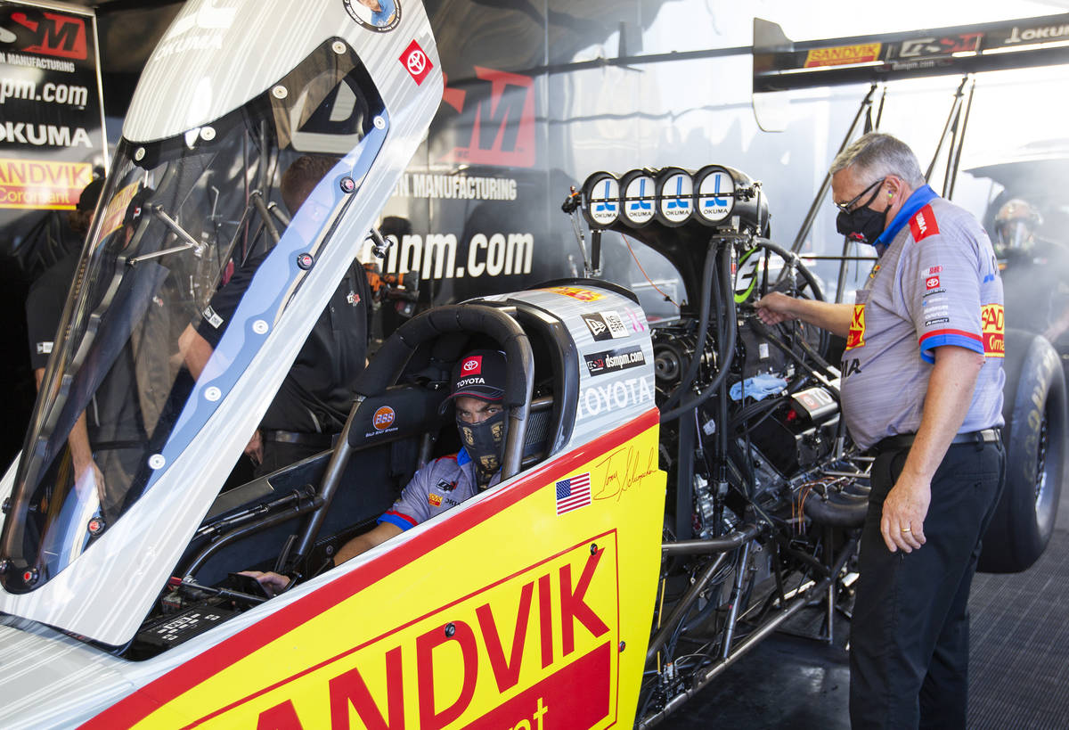 Top Fuel driver Tony Schumacher warms up his car before racing in the qualifying round of the D ...