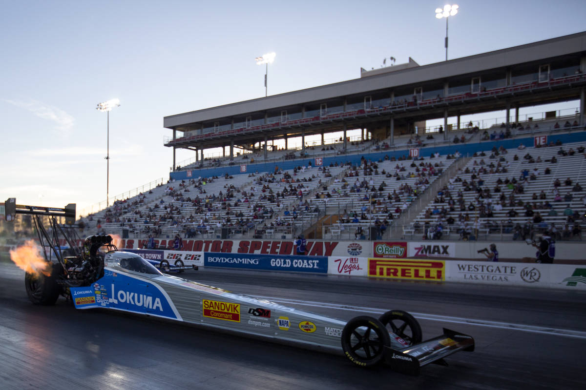 Tony Schumacher competes in a qualifying round of the Dodge NHRA Finals at Las Vegas Motor Spee ...
