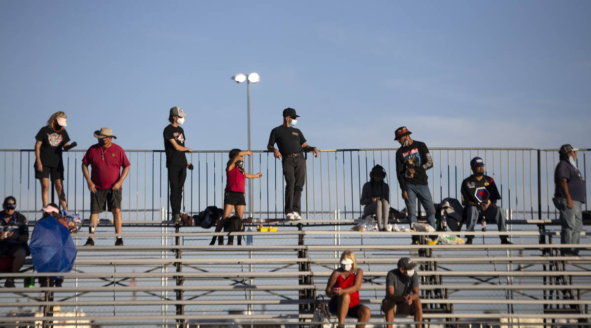 Fans sit apart to maintain social distance and prevent the spread of coronavirus during the Dod ...