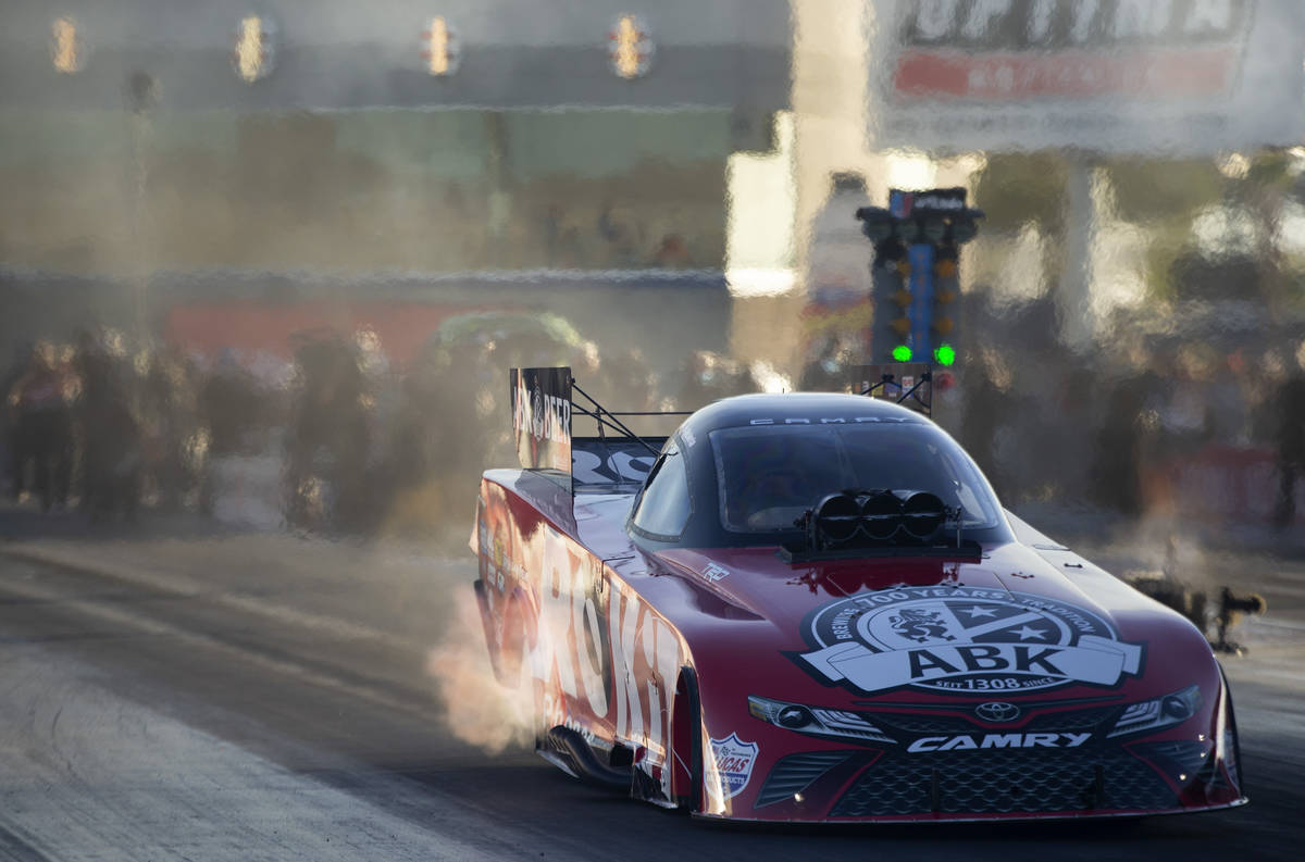 Funny Car racer Alexis DeJoria drives in the Dodge NHRA Finals at Las Vegas Motor Speedway on S ...