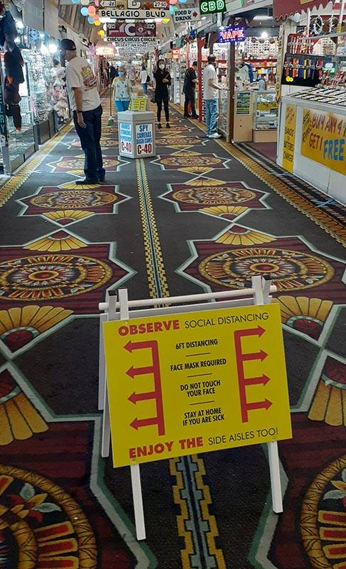 Signs placed in several spots remind patrons to follow rules on social distancing and various p ...