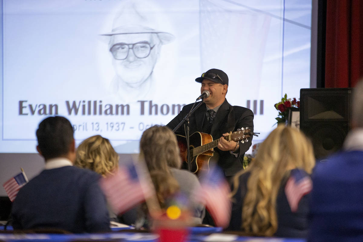 Elan Thompson, son of Navy veteran Evan Thompson III, sings a country song during his father's ...