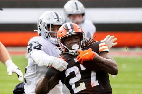 Las Vegas Raiders strong safety Johnathan Abram (24) tackles Cleveland Browns running back Kare ...