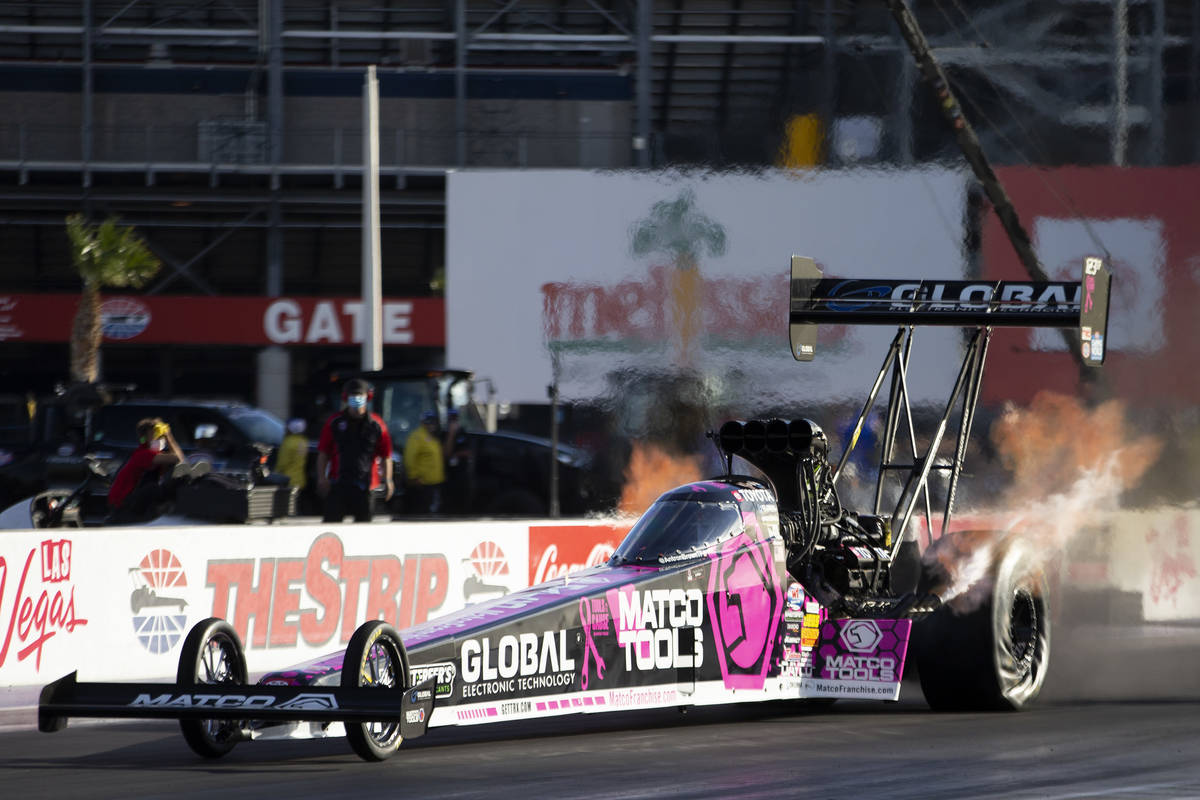Top Fuel driver Antron Brown races during the Dodge NHRA Finals at Las Vegas Motor Speedway on ...