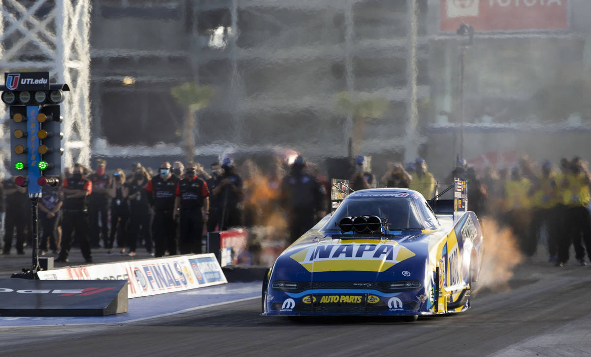 Funny Car driver Ron Capps races during the Dodge NHRA Finals at Las Vegas Motor Speedway on Su ...