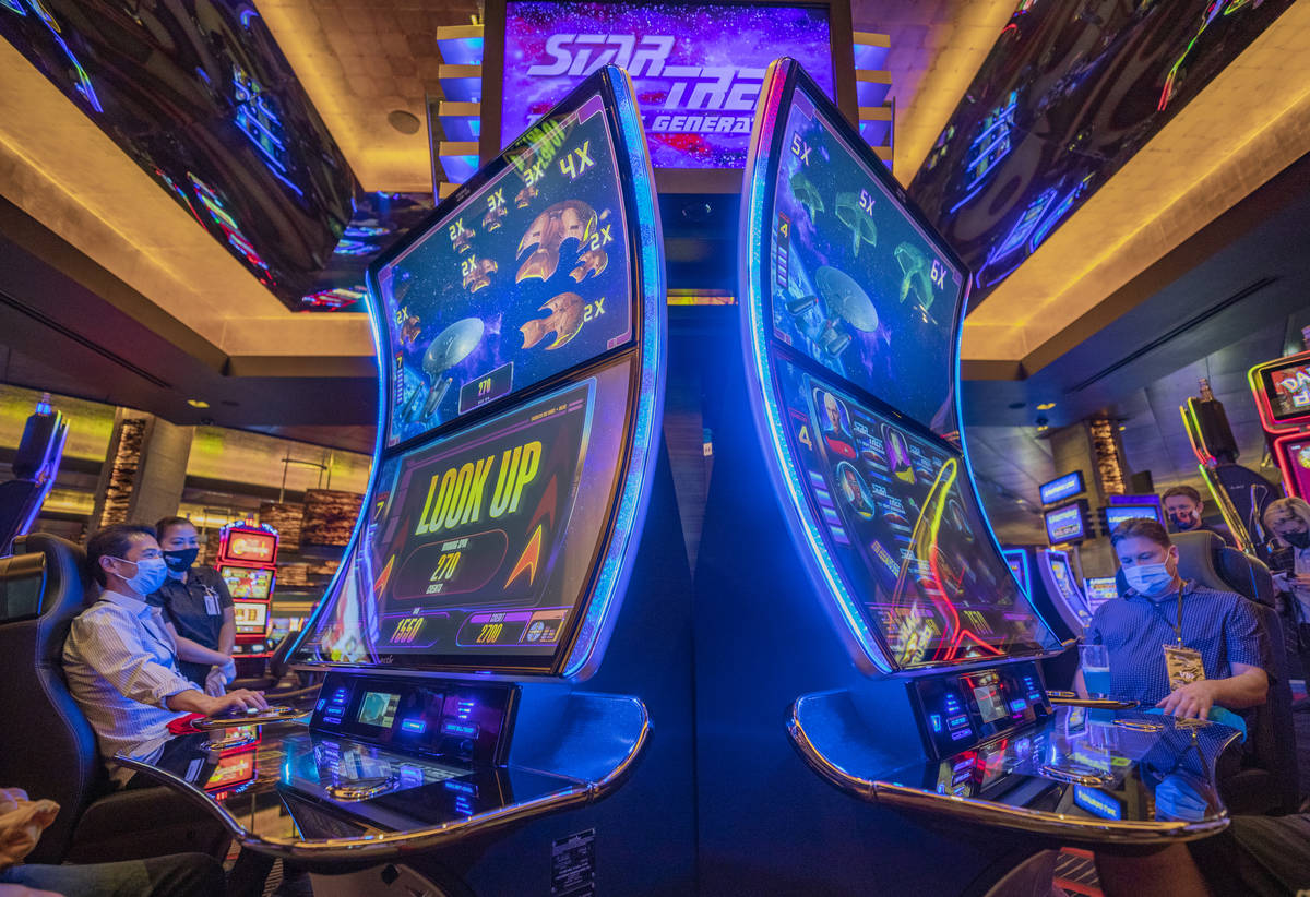 Individuals play Aristocrat Technologies' new Star Trek: The Next Generation Slot Game during t ...