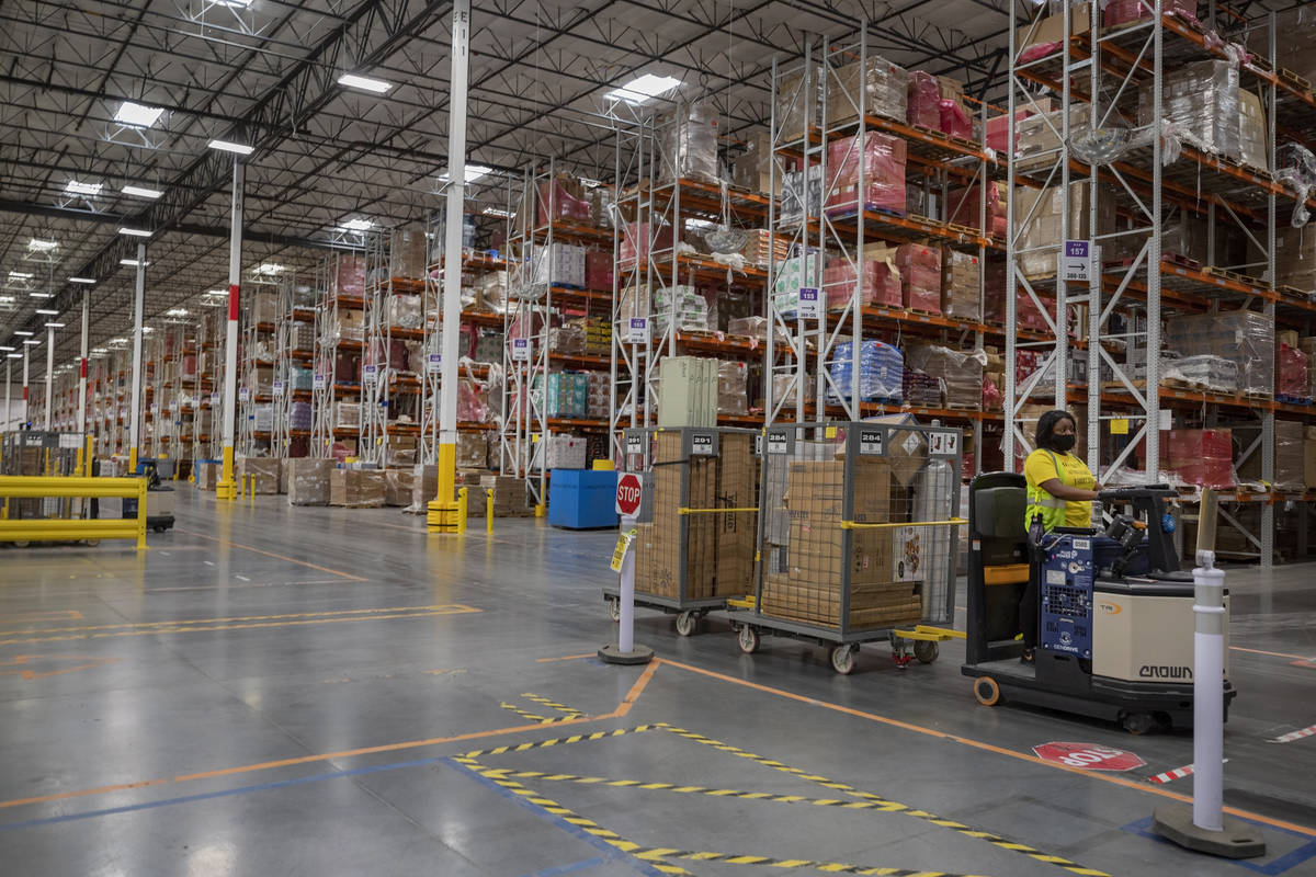 A worker is seen at an Amazon warehouse in North Las Vegas on Thursday, July 30, 2020. (Elizabe ...