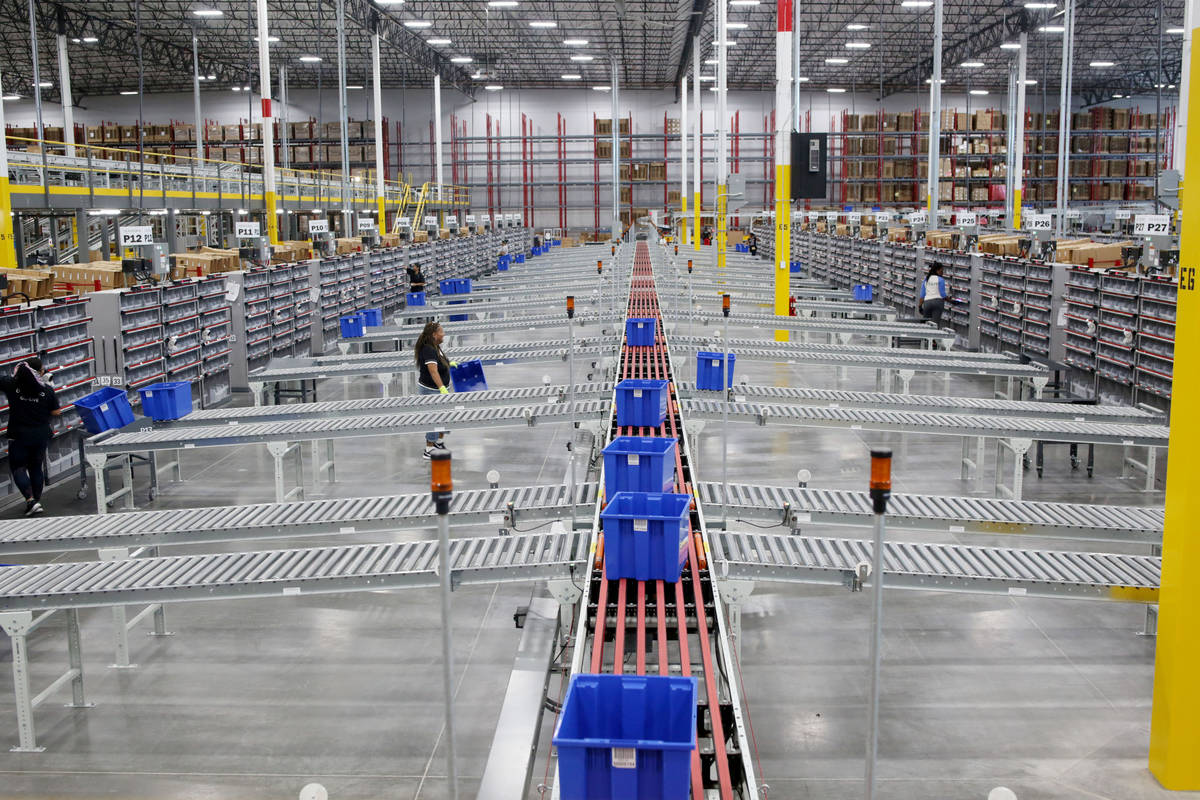 Warehouse workers sort product at a Sephora distribution center, a 714,000-square-foot facility ...