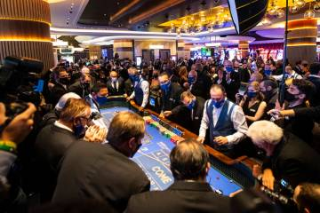 The first roll of the dice is thrown at a craps table at Circa during the grand opening event i ...