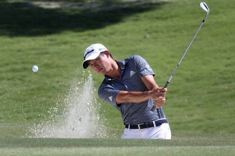 Collin Morikawa hits a chip shot during the 2020 Shriners Hospitals for Children Open practice ...