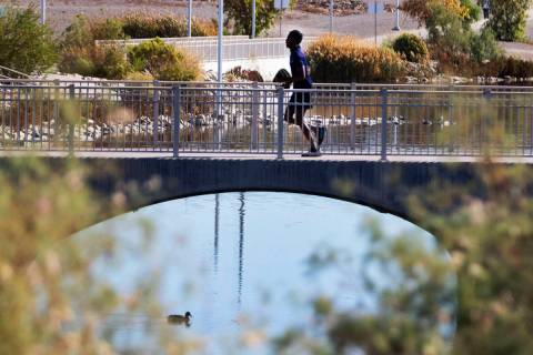 A man is jogging on pedestrian bridge at Cornerstone Park, on Thursday, Nov. 5, 2020, in Hender ...