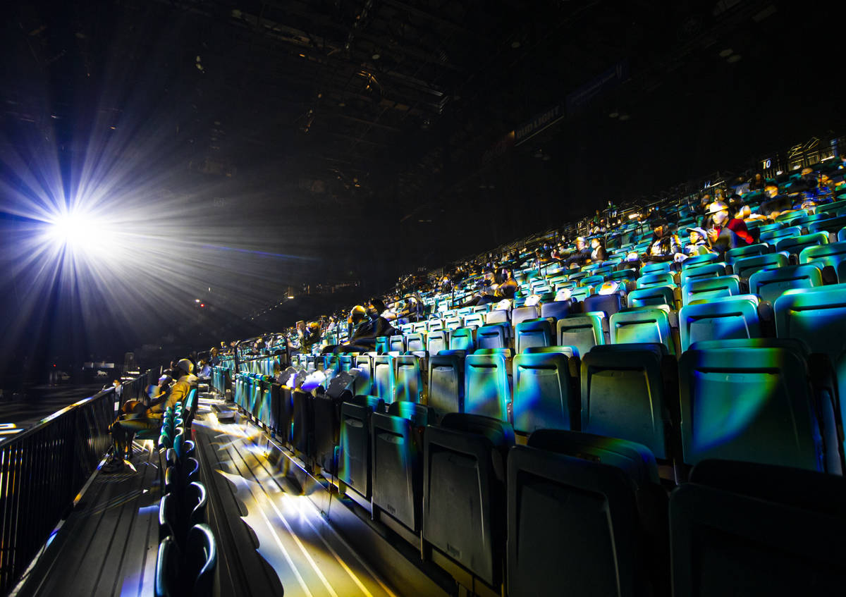 """People sit socially distanced at the start of the Jabbawockeez' new production, """"Timeless, ..."""