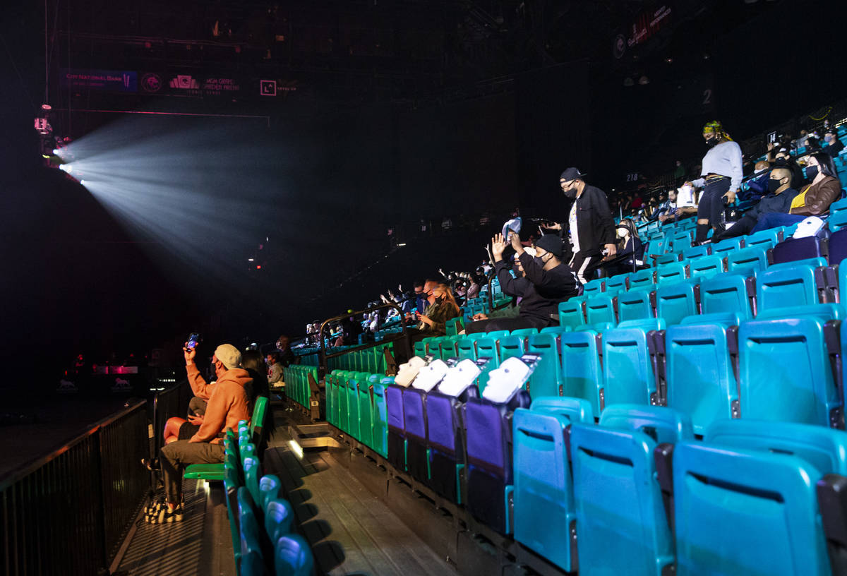 """People watch as the Jabbawockeez perform in their production, """"Timeless,"""" at the MGM ..."""