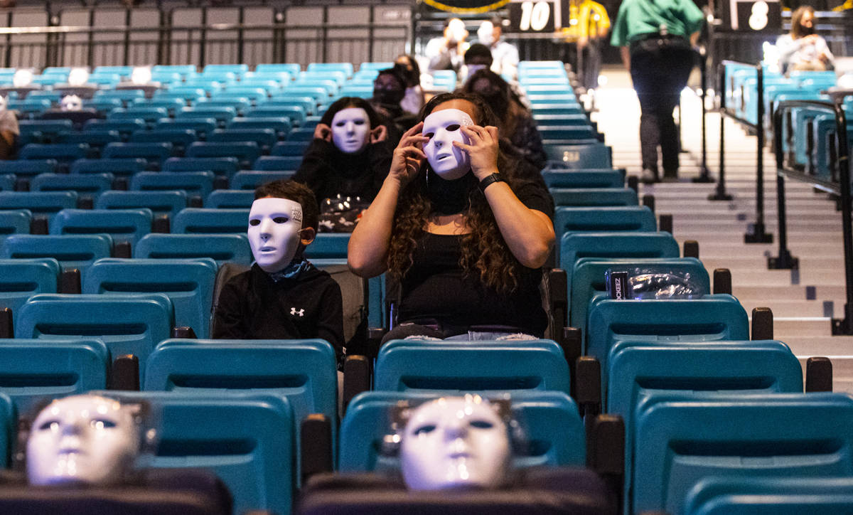 People pose in their Jabbawockeez masks before the beginning of the group's new production, &qu ...