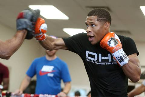 Boxer Devin Haney hits the mitts during a boxing gym workout at Title Boxing gym in Las Vegas, ...