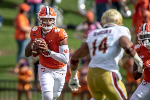 Clemson quarterback D.J. Uiagalelei (5) passes the ball during the first half an NCAA college f ...