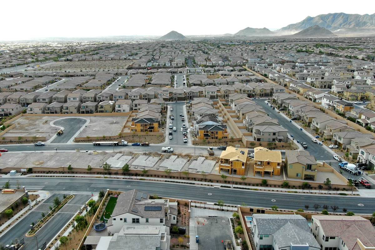 An aerial view of new home construction in Woodlands at Skye Canyon, a housing development near ...